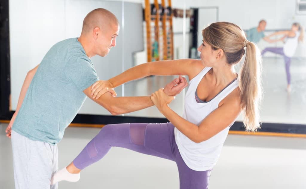Woman-Performing-Groin-Kick-During-of-self-Defense